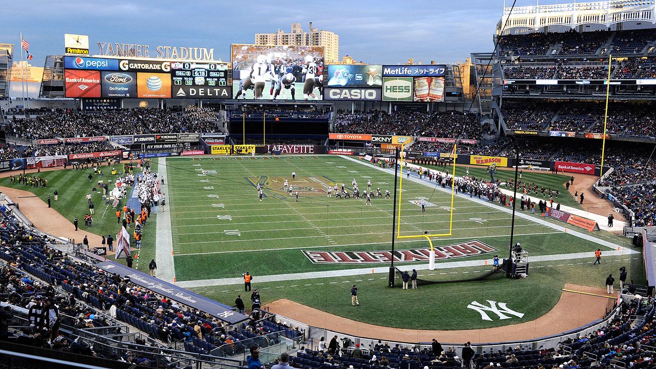 Historic football rivalry runs wild in Yankee Stadium