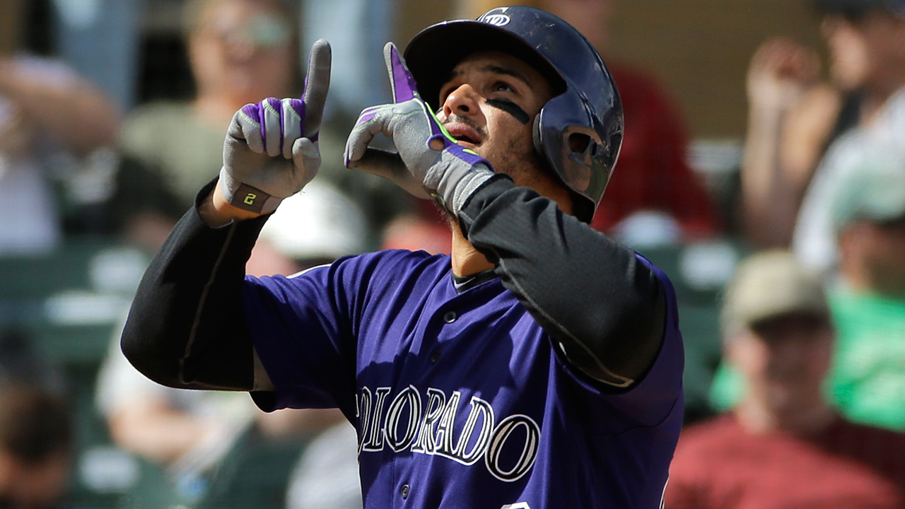 Arenado launches two homers in Rox's win