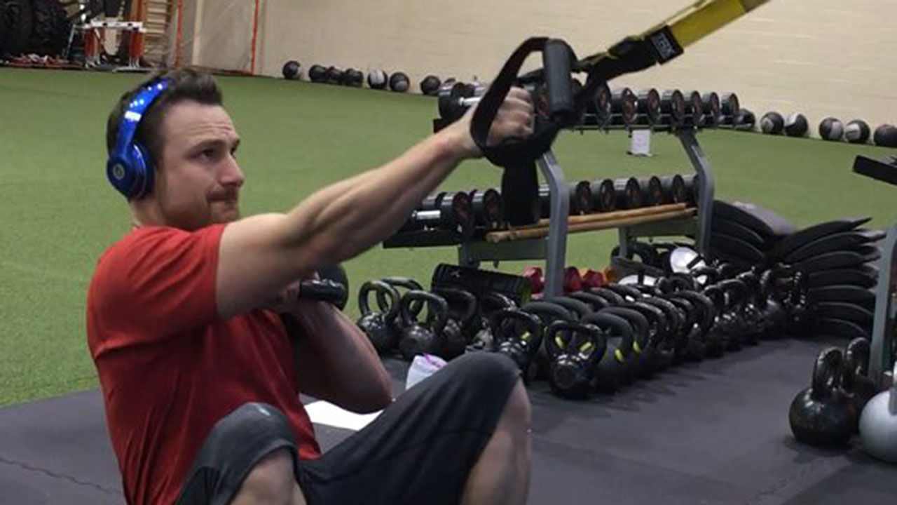 Lucroy brothers pushing each other during workouts