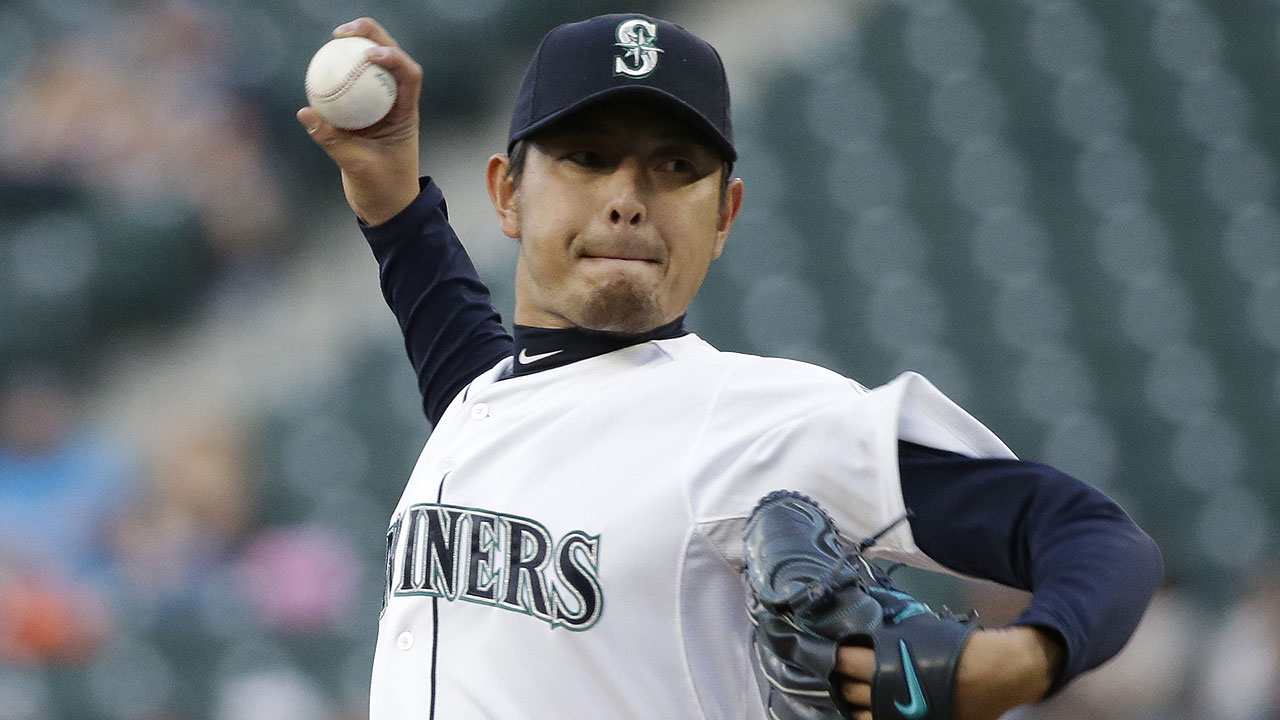 Iwakuma toils, but improves over rehab start