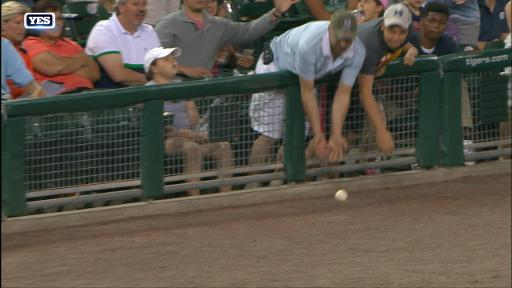 Young fan throws ball back from stands