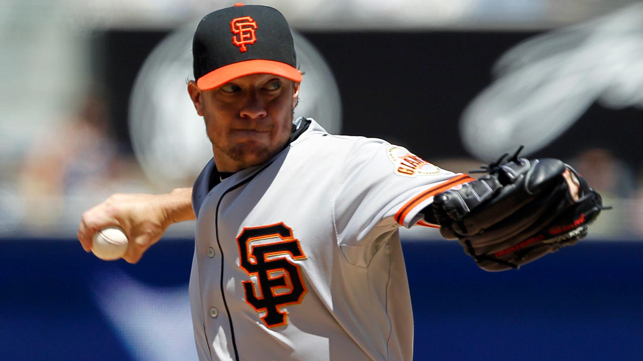 Back tightness slowing down Peavy's rehab